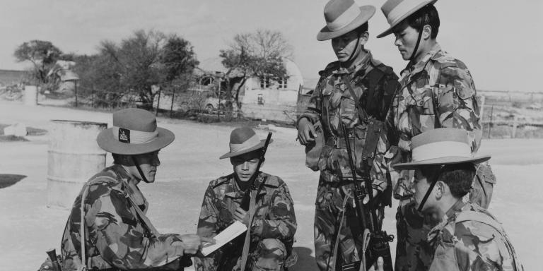 Gurkhas being briefed before a patrol at the British Sovereign Base of Dhekelia, Cyprus, 1974
