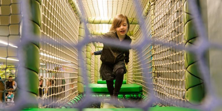 A child on the Play Base assault course