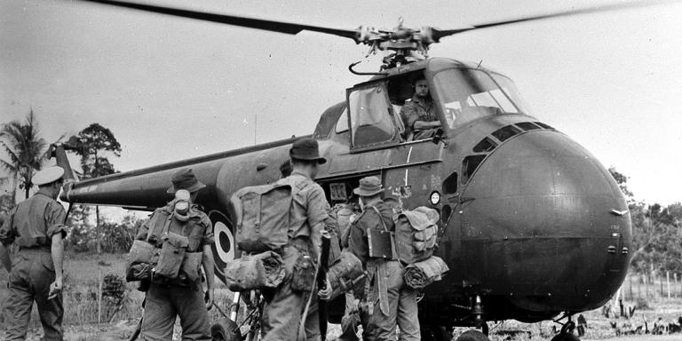 Soldiers boarding a Westland Whirlwind helicopter for a patrol, 1957