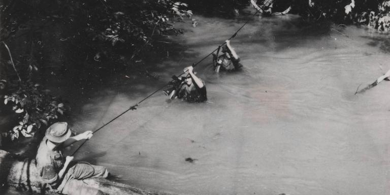 Troops negotiating waterway in the Malayan jungle, 1959