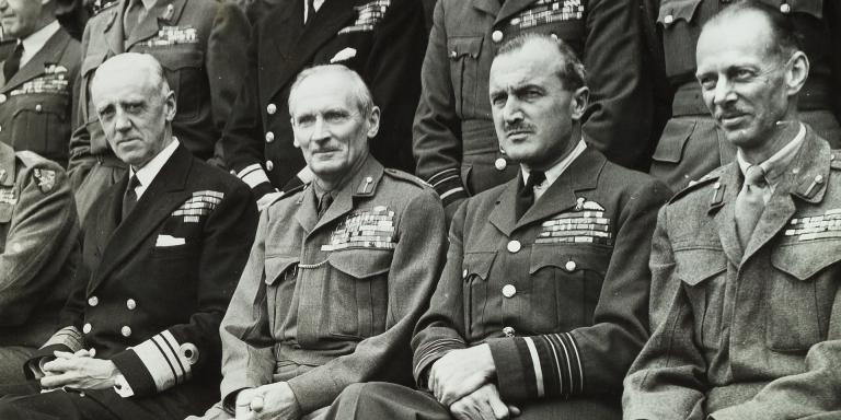 Montgomery and General Sir Miles Dempsey watching a parade.