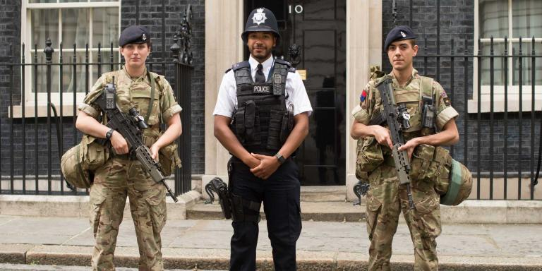 Soldiers of The King's Troop, Royal Horse Artillery, perform security duties at 10 Downing Street alongside armed police officers, Operation Temperer, May 2017