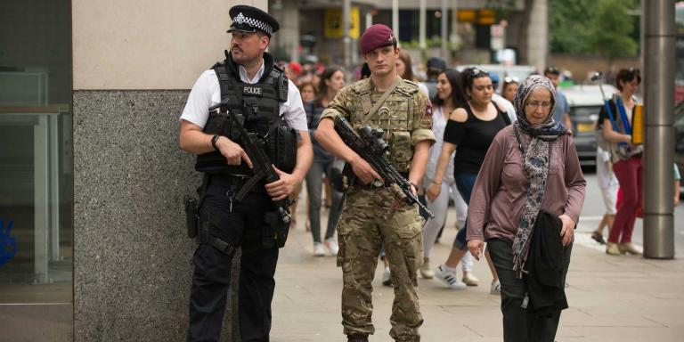 A soldier of 2nd Battalion, The Parachute Regiment, patrols with a police officer during Operation Temperer, 28 May 2017