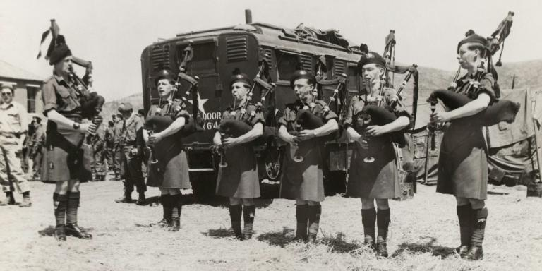 Royal Ulster Rifles pipers playing at the ceremony to award the Gloucestershire Regiment and 170th Independent Mortar Battery the US Presidential Unit Citation, 8 May 1951