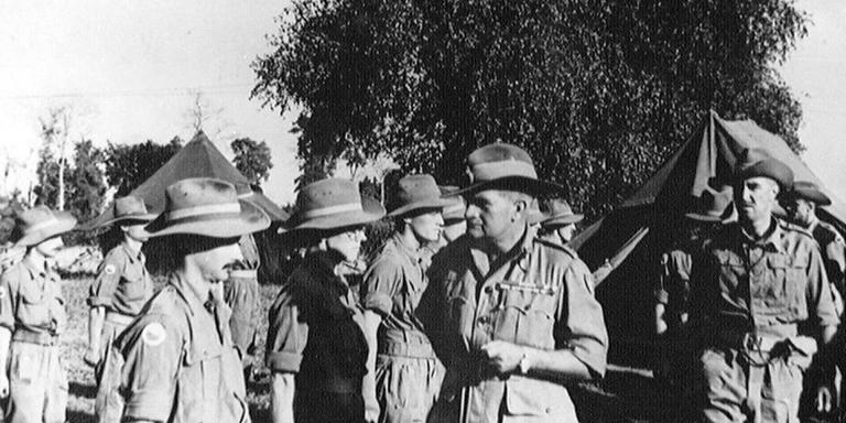Lieutenant-General Sir William Slim (second right) meets members of 11th (East African) Division in Burma, 1945