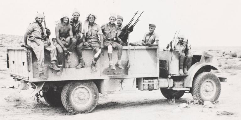 Long Range Desert Group lorry fitted with three sets of twin Vickers Class K-guns, c1942