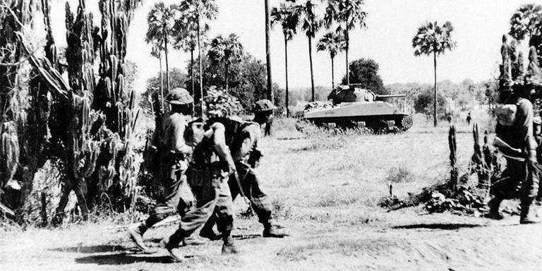 A Sherman tank of the 9th Royal Deccan Horse advancing with the infantry, Burma, 1945