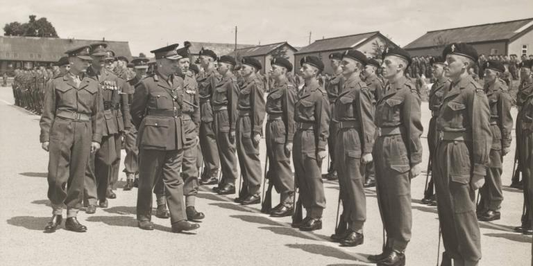 Major-General SW Joslin inspecting the passing out parade of 'C' Company, Royal Electrical and Mechanical Engineers, Honiton Camp, 1952