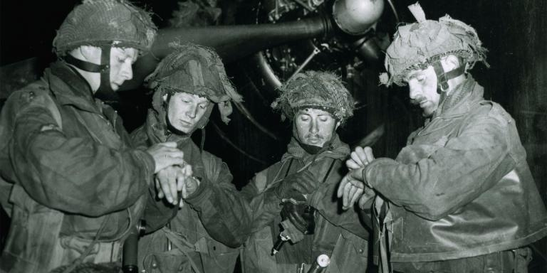 Airborne troops synchronising their watches before D-Day invasion, 5 June 1944