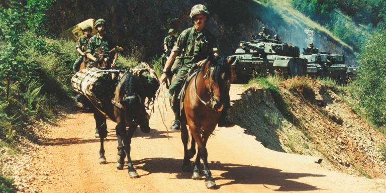 King's Royal Hussars on mounted patrol alongside their Challenger tanks, Mrkonjic Grad, Bosnia, 1997