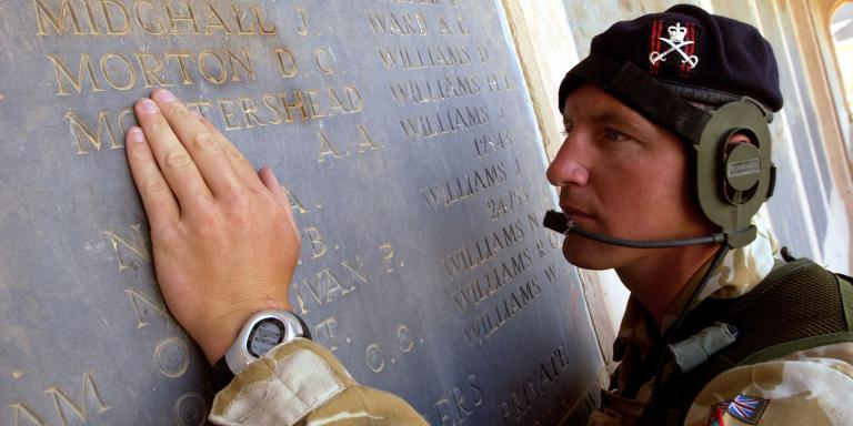 A sergeant of the Army Physical Training Corps, finds his namesake amongst the list of the fallen from the Mesopotamia campaign during World War One, July 2004
