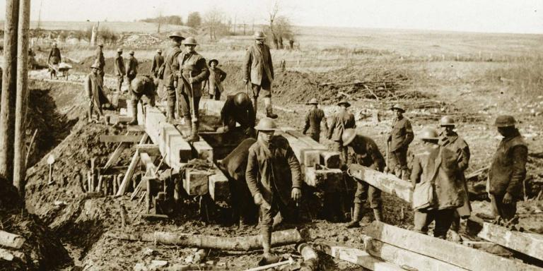 Royal Engineers bridging a stream, c1917