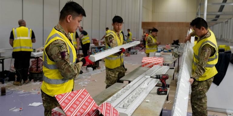 Soldiers of the Queen's Gurkha Engineer Regiment help build Nightingale Hospital, 27 March 2020