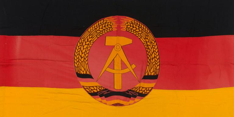 East German flag taken from outside the Soviet Military Cemetery at Treptow Park in East Berlin by a member of BRIXMIS, 1974